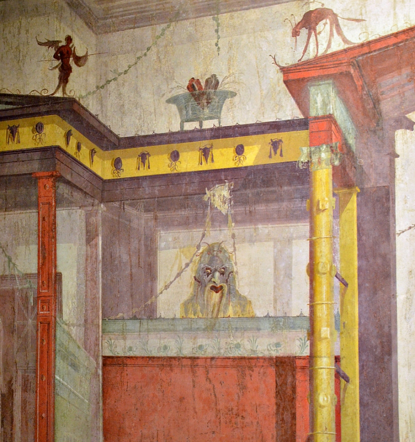Detail of South wall of the Room of the Masks, 2nd Pompeian style.