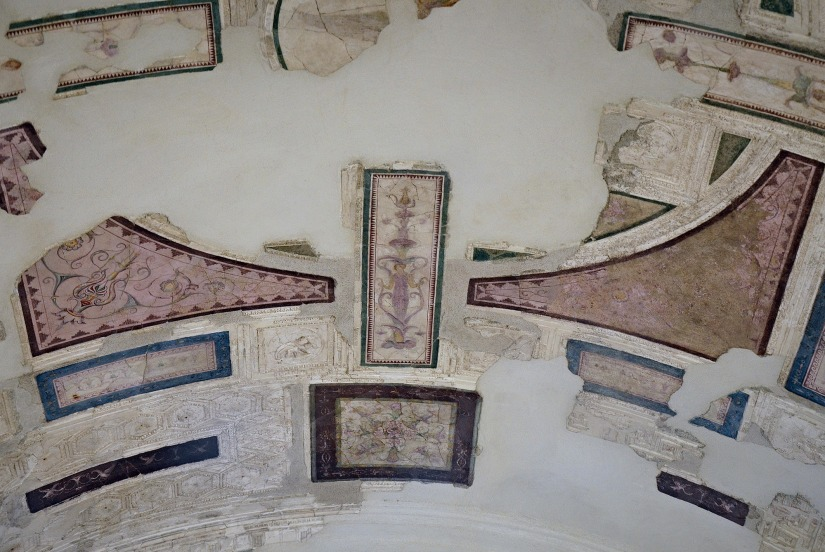 "The upper cubiculum so-called ""Emperor's Study"": central section of the ceiling with decorative divisisions in stucco and painting, in the centre a panel with plant corollas."