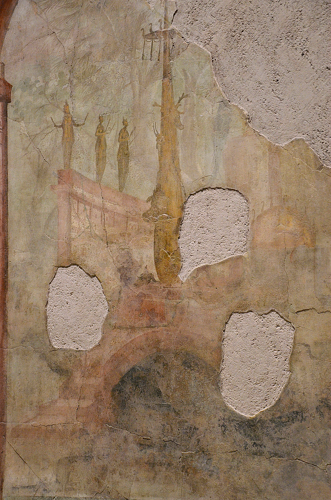 Fresco detail in the right wall of the triclinum depicting a sacred and rural landscape.