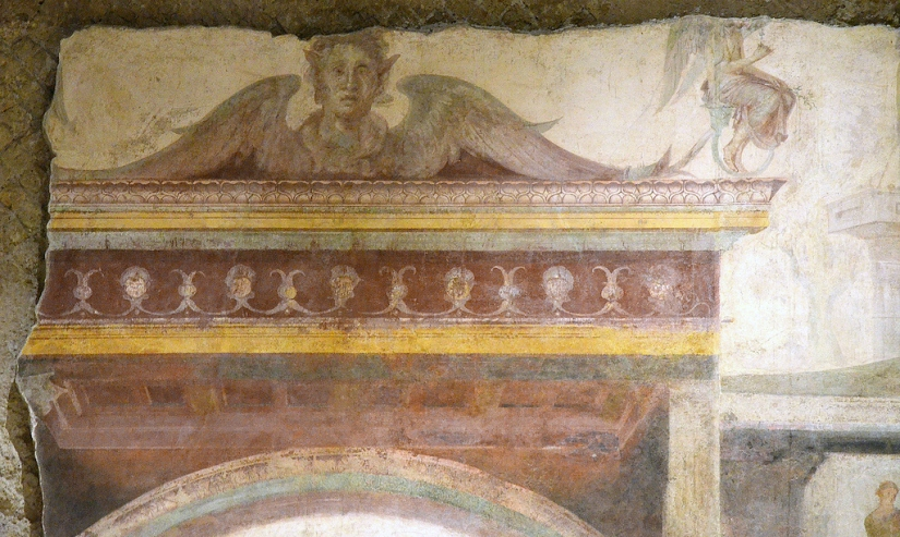 Detail of fresco on the back wall of the tablinum.
