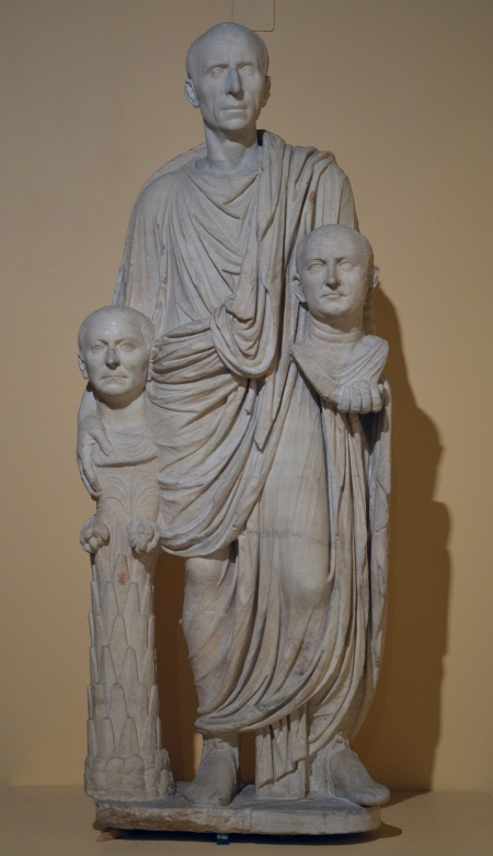 The so-called Togatus Barberini group, a funerary statue depicting a Roman senator holding the imagines (effigies) of deceased ancestors, late 1st century BC, head (not belonging) middle 1st century BC, Centrale Montemartini, Rome