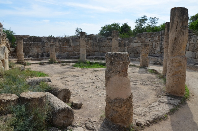 The gymasium's latrines, a semicircular structure with a roof supported on columns and a capacity of 44, Salamis