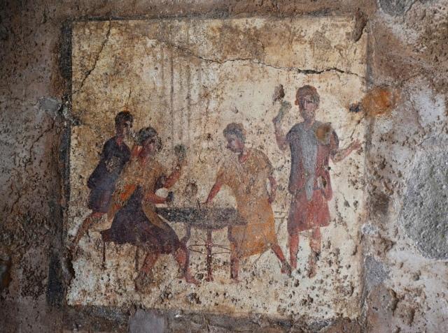 Dice players fresco from the Osteria della Via di Mercurio (VI 10,1.19, room b), in situ wall fresco, Pompeii. Saturnalia