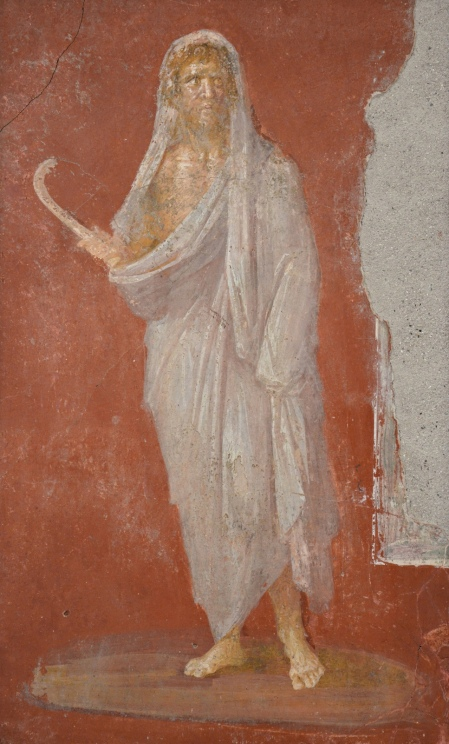 Saturn with head protected by winter cloak, holding a scythe in his right hand, fresco from the House of the Dioscuri at Pompeii Naples Archaeological Museum. Saturnalia