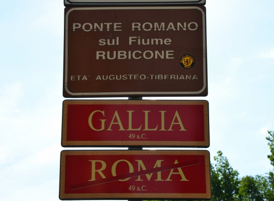 Street signs marking the northern boundary of Italy, Roman bridge over the Rubicon river, Savignano sul Rubicone, Italy