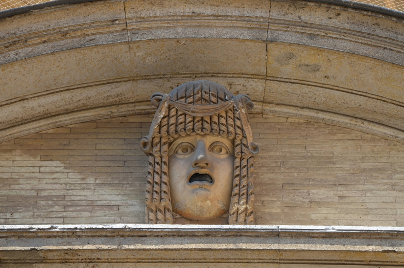 Theatrical mask from the South Theatre (Odeum) at Hadrian's Villa, female figure of tragedy wearing the onkos (topknot), Cortile del Belvedere, Vatican Museums