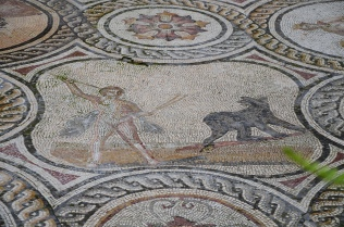 Callisto transformed into a bear by Zeus, is about to be slayed by her own son Arcas. Baetica mosaics, Seville.
