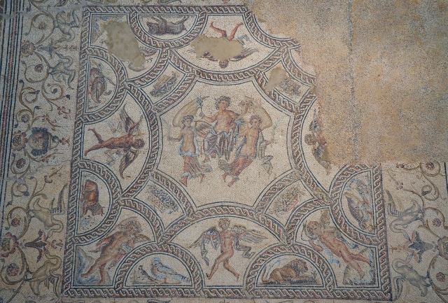 Mosaic of the Seasons, in the central octagon the Apotheosis of Annus (Year) between two winged victories, in the corners allegories of the Four Seasons, second half of 2nd century AD or early 3rd century AD, Museo Histórico Municipal de Écija. Image © Carole Raddato. Baetica mosaics.