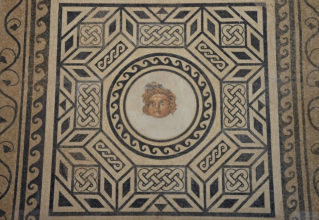 Mosaic with Medusa depicting with a round, childlike face, 2nd century AD, found in 1959 at the Plaza de la Corredera, Salón de los Mosaicos (Hall of Mosaics) - Alcazar of the Christian Monarchs, Cordoba