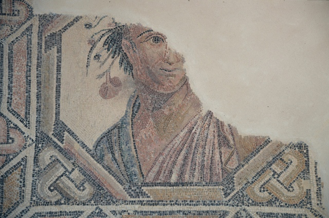 Detail of the mosaic floor with a central octagonal medallion portrait, probably an allegory of Spring, that paved the oecus of the Villa Villa del Alcaparral, Roman Mosaic Museum, Casariche