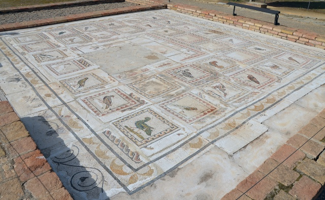 The Bird Mosaic consisting of a central panel surrounded by 35 small squares representing different species of birds, Italica. Image © Carole Raddato.