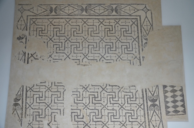 Black and white geometric mosaic with swastikas motifs that paved the triclinium of the Villa del Alcaparral, Roman Mosaic Museum, Casariche