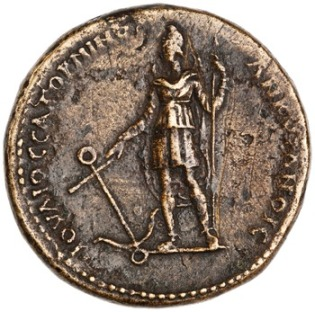 Commemorative coin minted by Julius Saturninus at Ancyra REV: man standing in a sleeved tunic, eastern pants and a Phrygian cap, holding a scepter in one hand and an anchor in the other, crescent behind him, with legend IOV›IOC | CATOPNINOC | ANKVPANOIC CC BY-NC 4.0 American Numismatic Society