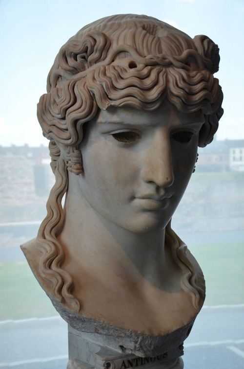 Head of Antinous that would have been part of a colossal statue with a wooden torso and marble extremities (acrolithic cult statue). Image © Carole Raddato. Marguerite Yourcenar exhibition.