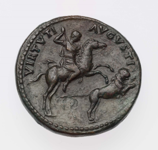 Revers of Medallion depicting Hadrian on horseback shooting a lion with a spear with the legend VIRTVTI AVGVSTI.
